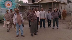 Albert and the rest of the Indians watch the Katrina Tour bus drive away.