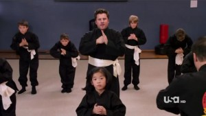 Shawn practices Wu-Shu with other students, ages 5-8.