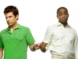 Shawn and Gus bump fists in a Psych promo.