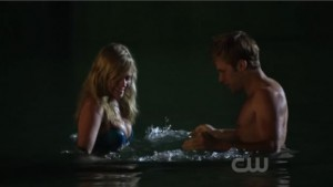 Lux and Eric, stripped to their underthings, splash around in the lake.