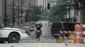 Rick observes the destruction as he rides down Forsyth Street.