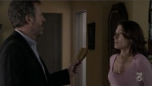 House gives Cuddy back her hairbrush.