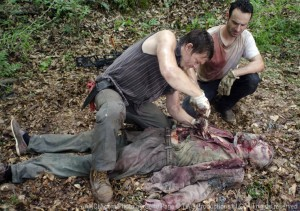 Daryl and Rick cut open a Walker to see what its last meal was.