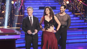 Tom Bergeron listens to the judges comments with Hope Solo and her partner, Maks.