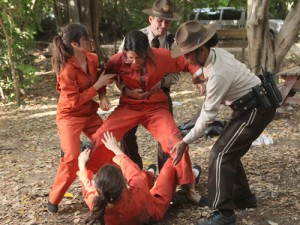 Emily and Spencer fight during community service.