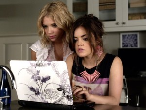 Hanna and Aria set up a dating profile for Ella.