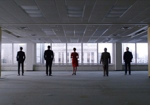 Pete, Don, Joan, Bert, and Roger stand in their new office space.