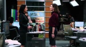 Sloan and Mac talk in the newsroom.