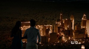 Maya and Neal gaze at a model of the New York City skyline.