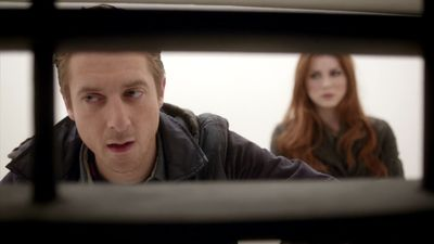 Rory and Amy behind bars on the Dalek spaceship